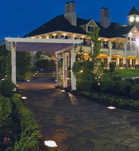 Cobble Lights provide low profile lighting that showcase your pergola or other garden focal point