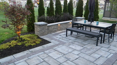 ... Nice Family Picnic Area On A Paver Patio With Pillar Wall Lights