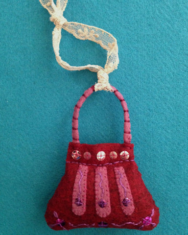 PURSE ORNAMENT, CRANBERRY #4 by artist Ulla Anobile