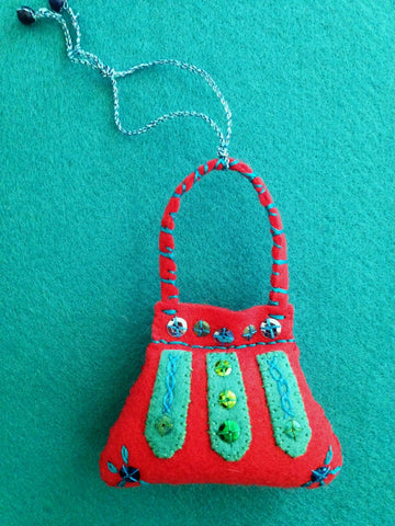PURSE ORNAMENT, LIPSTICK RED WITH PERSIAN BLUE #5 by artist Ulla Anobile