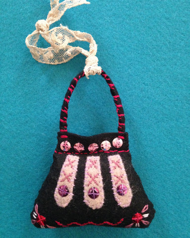 PURSE ORNAMENT, BLACK WITH OLD ROSE #1 by artist Ulla Anobile