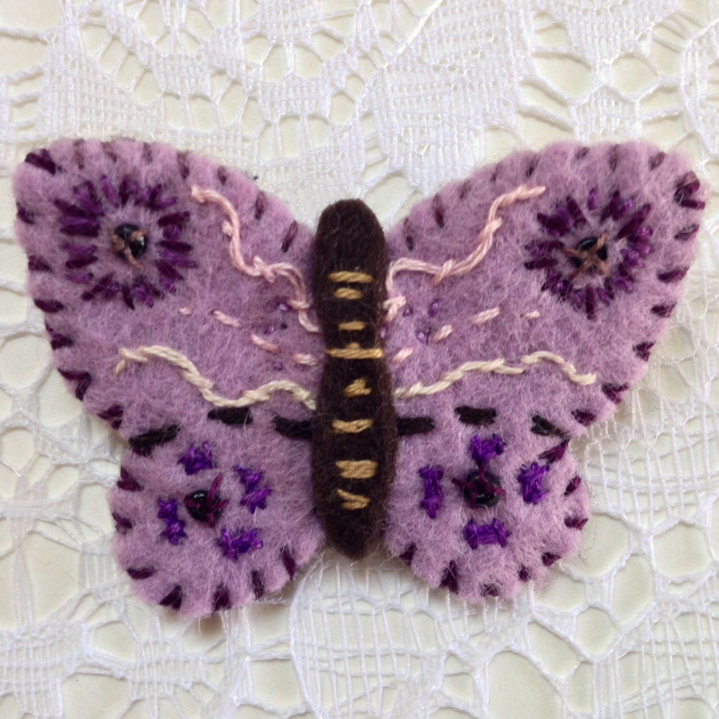 """Mauve Butterfly Pin #1"" by artist Ulla Anobile"