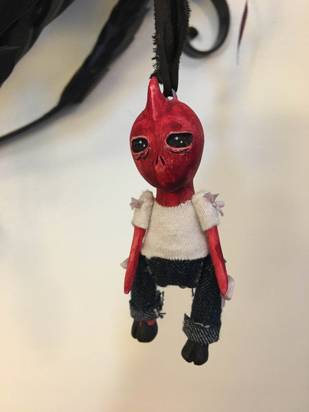 Red Alien Ornament by artist Richelle Nicole