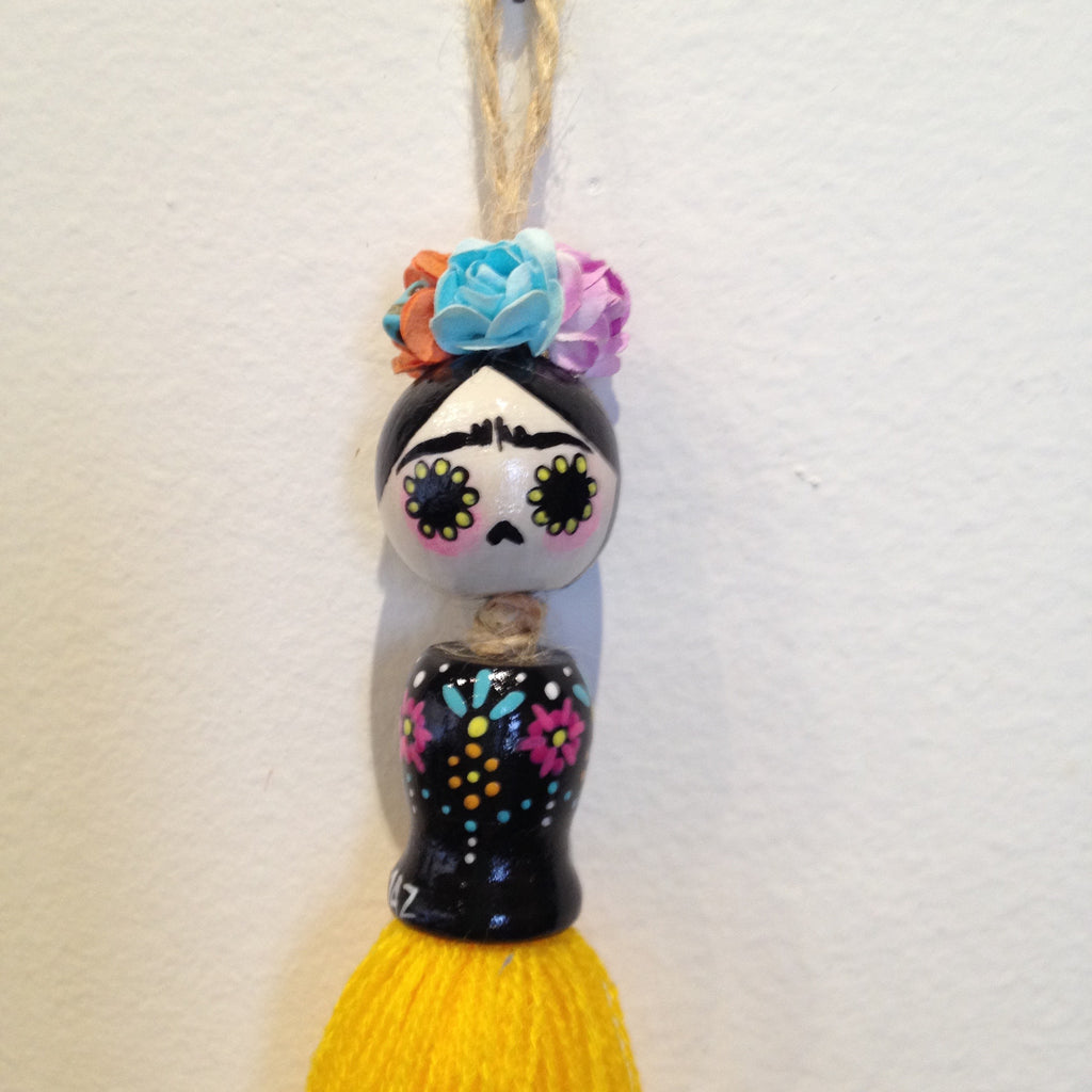 """Frida Tassel Doll, Yellow"" by artist Jazmin Molina"
