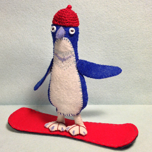 """Little Blue Penguin on Snowboard"" by artist Ulla Anobile"
