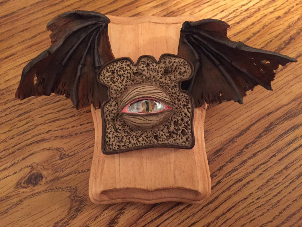 Pumpernickel Demon Toast by artist Joe Vollan