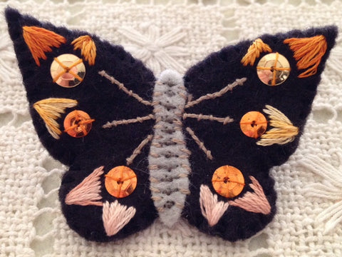 BUTTERFLY PIN (orange sequins) by artist Ulla Anobile