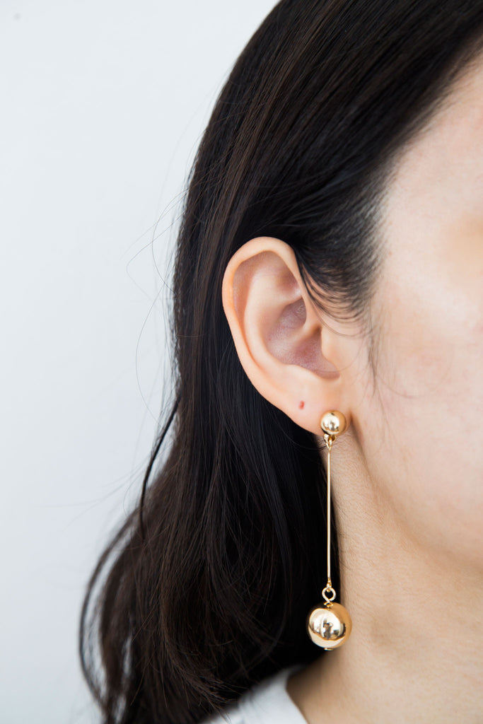 Belle Ball Earrings, modern minimal jewelry. Elevated ball earrings, one of this season's favorite. Features elegant spherical details in a polished finish for a classic shine, moving like a pendulum swing.