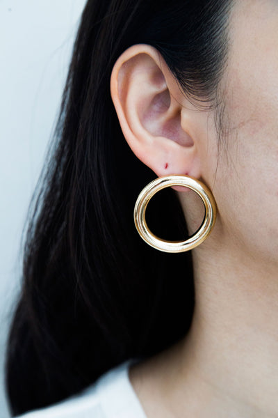 Jo Circle Earrings, modern elevate hoop earrings. Modern statement earrings that make any look a showstopper. A chic way to lift your everyday looks.