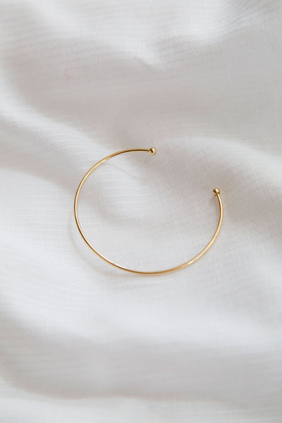 Coco Cuff, minimal jewelry. Modernistic and simple. The lovely round speckle of gold shines on it's own or in a pile.