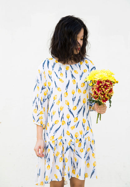 Tulip dress. Happy go lucky dress with a dropped waist. The dress falls elegantly into a lively, relaxed silhouette and ultra comfy. Look chic in this all over tulip prints!