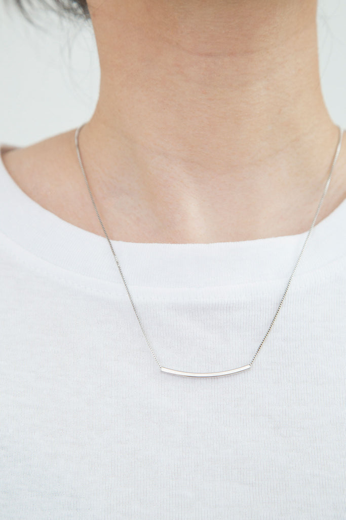 Bar Necklace (.925), minimal jewelry. Looks graceful and delicate on it's own or in a pile. Adjustable - can be worn short, resting gently at your clavicle, or dropped longer for a flash of silver.
