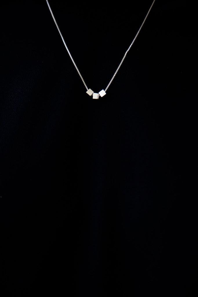 Cube necklace, minimal jewelry. Sits beautifully on its own or as a layering piece. Gracefully accentuates the neckline. Adjustable - can be worn short or long. Makes a beautiful .925 classic.