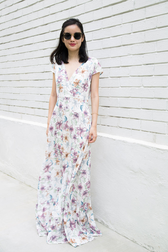 Ginger Floral Maxi Wrap Dress. In a super flattering and relaxed style, this soft color floral maxi dress has gorgeous written all over it. Wrap bodice dresses never get old, this is the kind of effortless dress you'll find any excuse to wear. 100% nursing friendly and bump friendly!