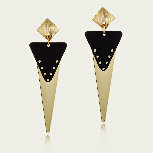 Statement long triangle Drops featuring shiny 18kt yellow gold plate and black patina enamel triangles hanging from brushed gold tone studs.