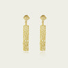 Featuring textured gold column shapes in 18kt yellow gold plate. Sterling silver ear posts are soldered to cube textured ear studs.