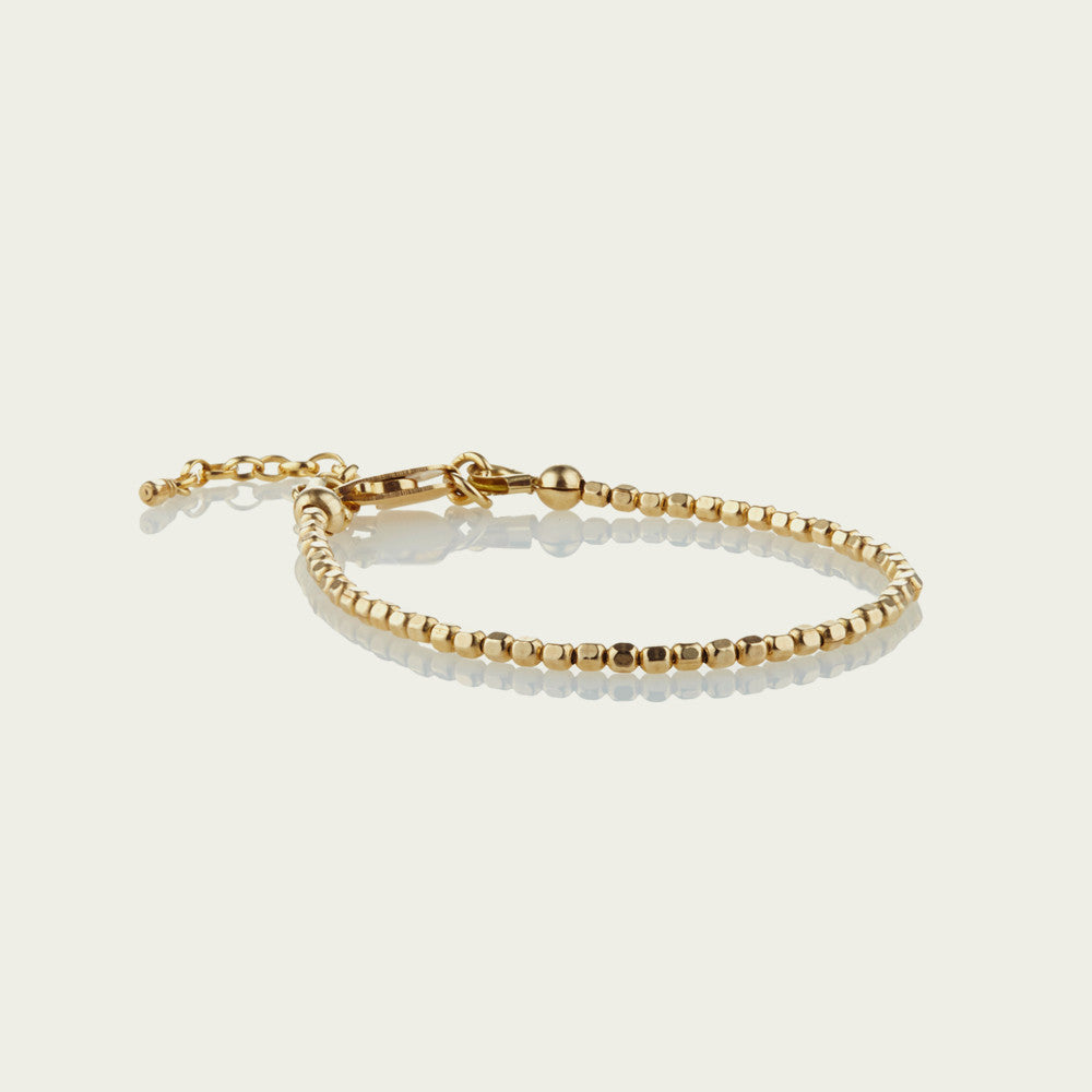 Tiny 14kt Gold-Fill faceted beads are strung on very strong wire to make this delicate best-selling piece. This gorgeous bracelet looks great stacked, with others from our precious metal range or on its own. Incredibly durable yet exquisitely delicate.