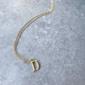 Initial necklace in matte gold-plate