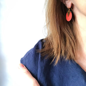 Disc earrings shown on