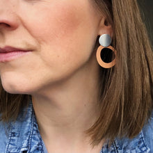 Load image into Gallery viewer, Halo earrings shown on. Kylie is wearing the nut earring in silver.