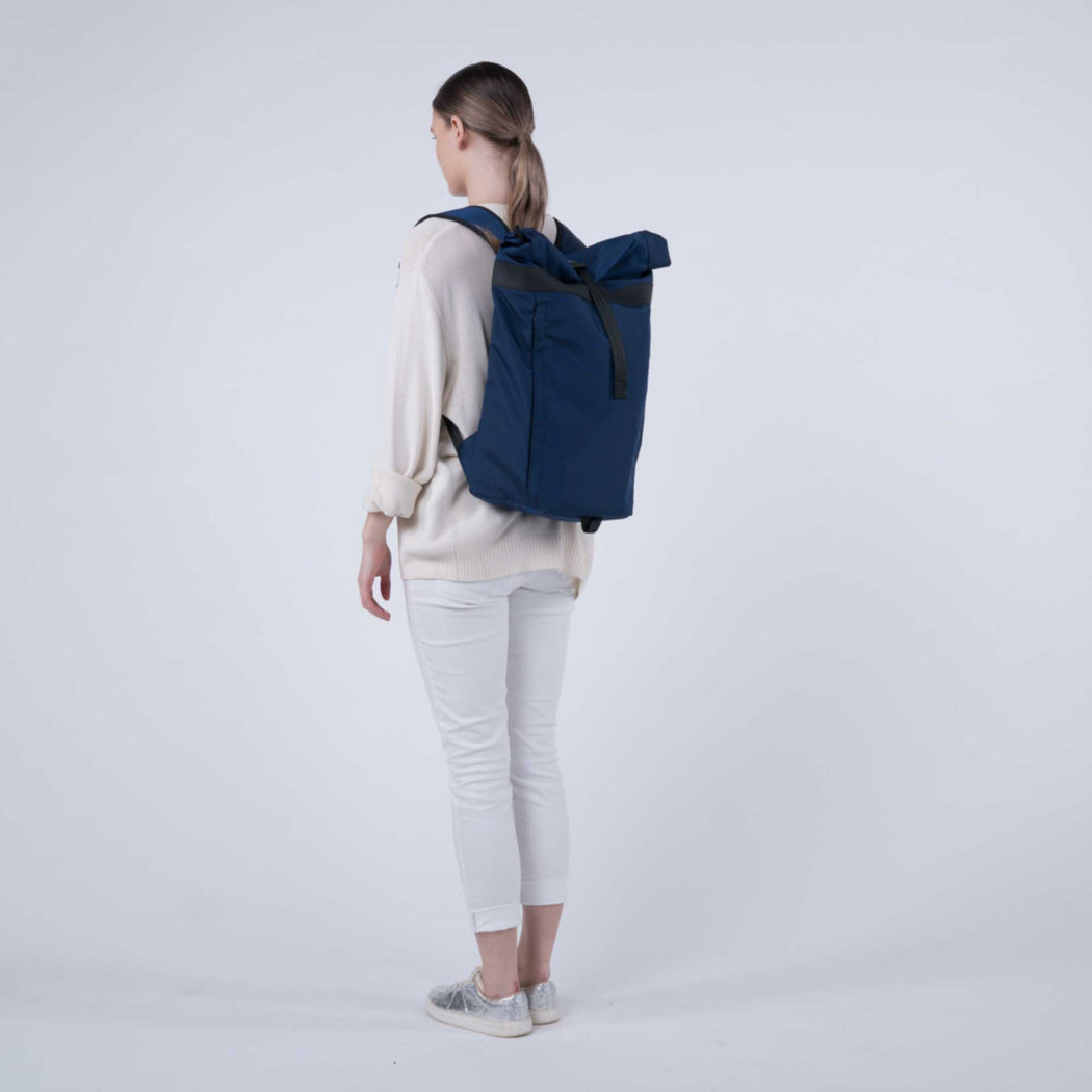 px weatherproof Invisible backpack rolltop dark blue - female model