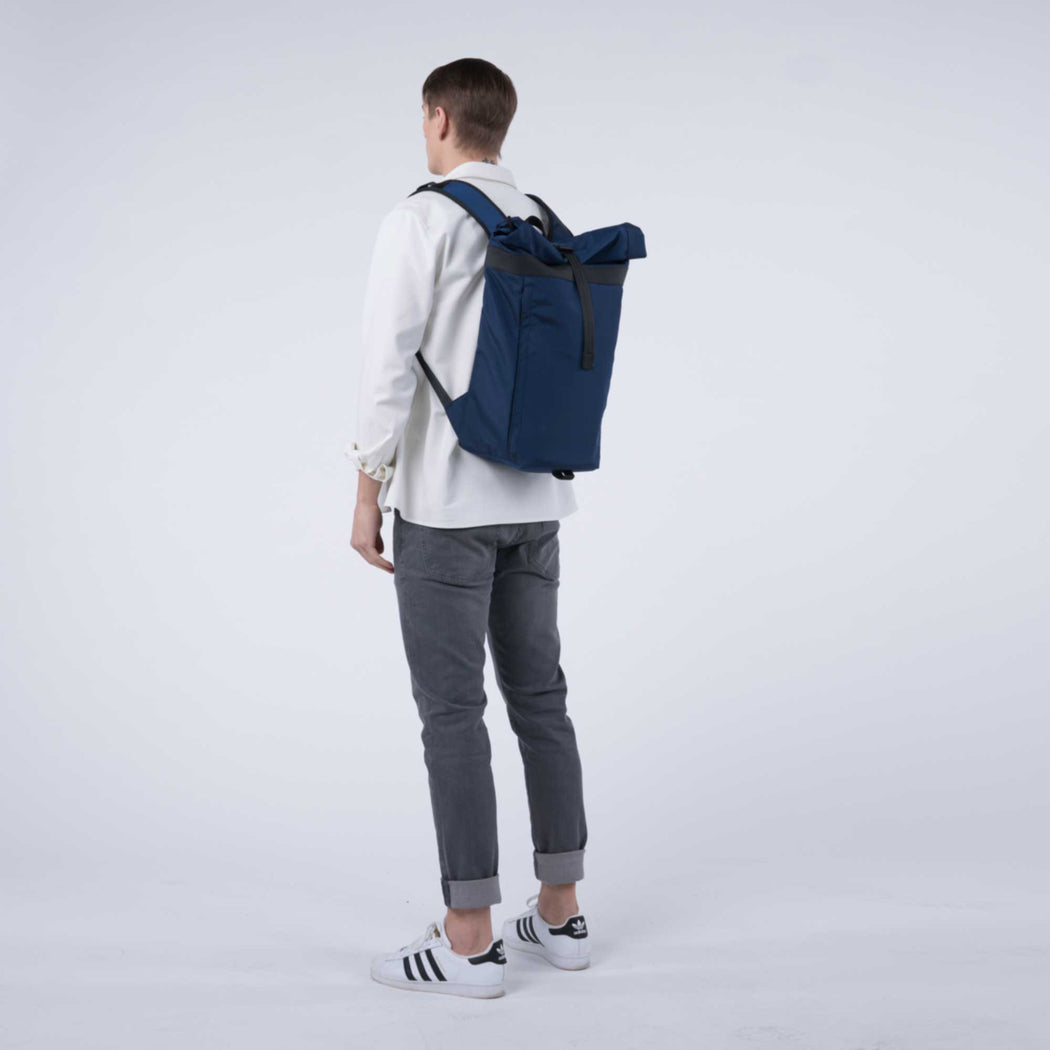 px weatherproof Invisible backpack rolltop dark blue - male model