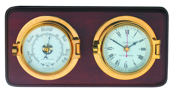 meridian zero channel range brass clock and barometer mounted on a wooden board