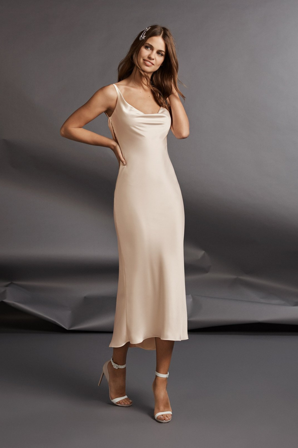 Whether you are looking a dress rotation for your big day, or something a little less traditional and more casual – our Unconventional Dress is the one for you. Featuring a sexy midi dress silhouette with 90s minimalism in on-trend colours (light pink or off-white), this wedding gown designed by Atelier Pronovias might just be the one.