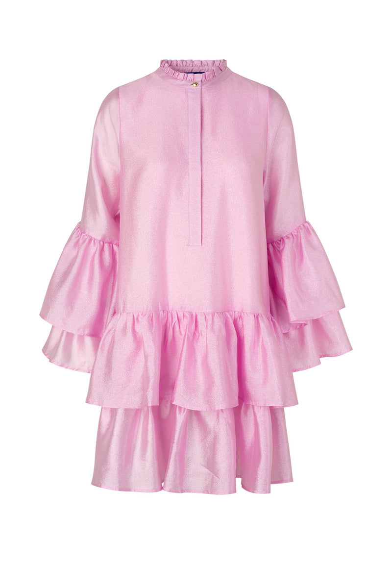"The Alfrida Dress in begonia pink is the perfect pick for Spring and Summer. Designed by Cras, the loose fit dress features dramatic ruffles on the arms and skirt. Pair with a classic boot, sneaker or sandal for a casual look! Cras only uses certified sustainable and natural fabrics, which reduces the footprint of our products immensely. The fabrics range from certified recycled polyester, the new ""green"" type of viscose Eco Vero, natural silk and organic cotton."