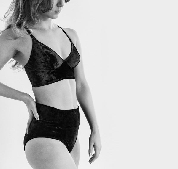 Designed by Fortnight Lingerie and Misfit Studios, this pull over bra is constructed with crushed stretch black velvet, bonded jersey straps and power mesh. A reinforced front panel and outer cup lining creates flexibility, comfort and support through movement. Made in Toronto, Canada.  All lingerie is final sale.
