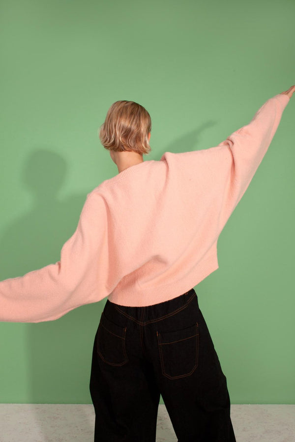 Our new lounge + WFH favourite. This is the ultimate lounge cropped jumper sweater featuring a round neckline, ribbed hem, cuff and neckline with wide sleeves. In a pale pink, we are loving pastels for the season ahead. Designed by L.F. Markey.