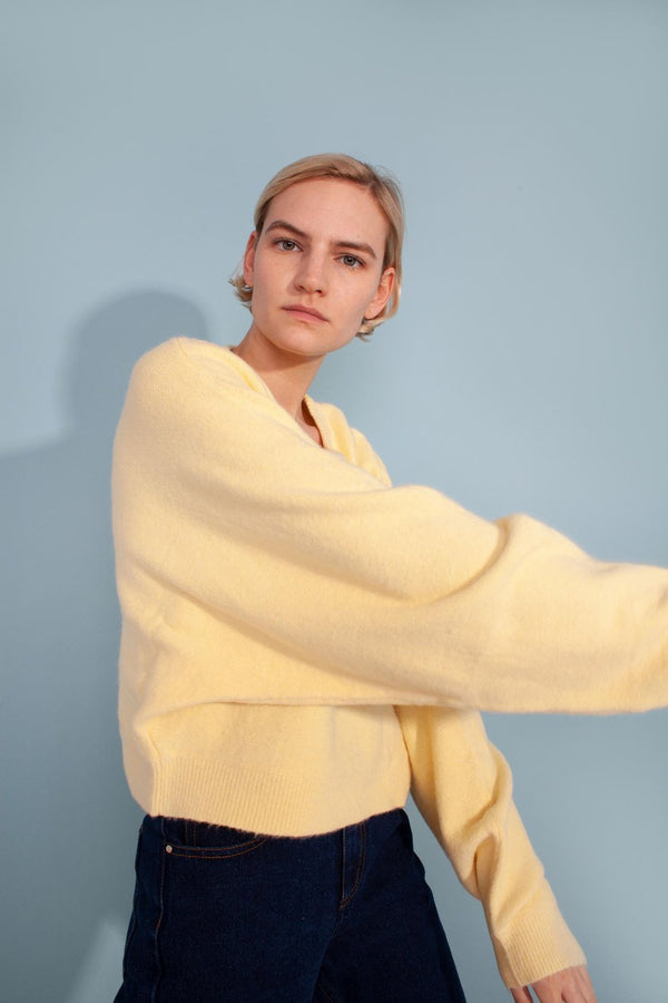 Our new lounge + WFH favourite. This is the ultimate lounge cropped jumper sweater featuring a round neckline, ribbed hem, cuff and neckline with wide sleeves. In a pale yellow, we are loving pastels for the season ahead. Designed by L.F. Markey.