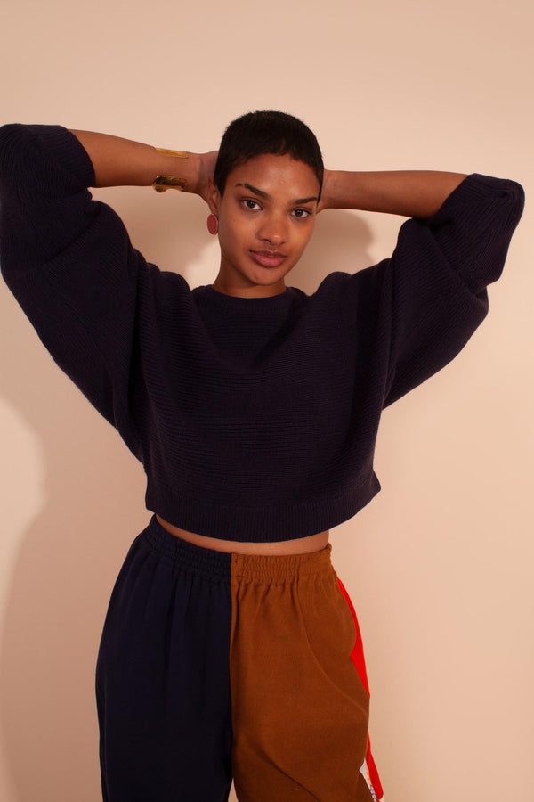 Looking for the perfect cropped knit sweater? Look no further. The Verne Knit Jumper is a wide cut cropped, ribbed jumper with a round neckline, ribbed hem, and wide sleeves. Available in both Navy and Terracotta. Designed by L.F. Markey, made from a merino wool blend. Looking for the perfect cropped knit sweater? Look no further. The Verne Knit Jumper is a wide cut cropped, ribbed jumper with a round neckline, ribbed hem, and wide sleeves. Available in both Navy and Terracotta. Designed by L.F. Markey, mad