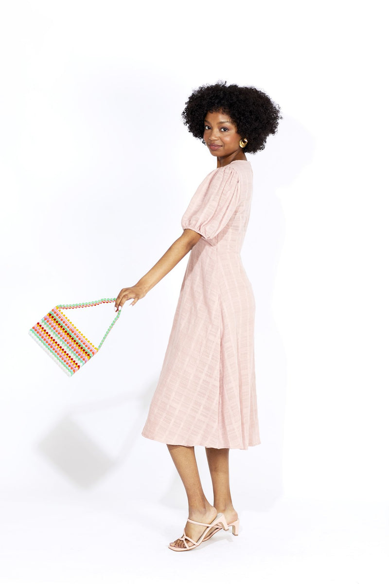 Kinda flirty, kinda refined. This Pia Midi Dress designed by Auguste is made from 100% textured cotton with a flattering bodice, puff sleeves, lined skirt and Sunday brunch appeal.