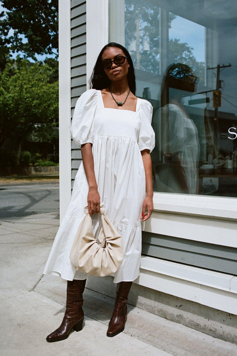 Serenity Now! Welcome the Summer months with this effortless  puff sleeve white casual dress by Bronze Age. She pairs perfectly with everything from pearls and heels to sneakers and a sun hat.