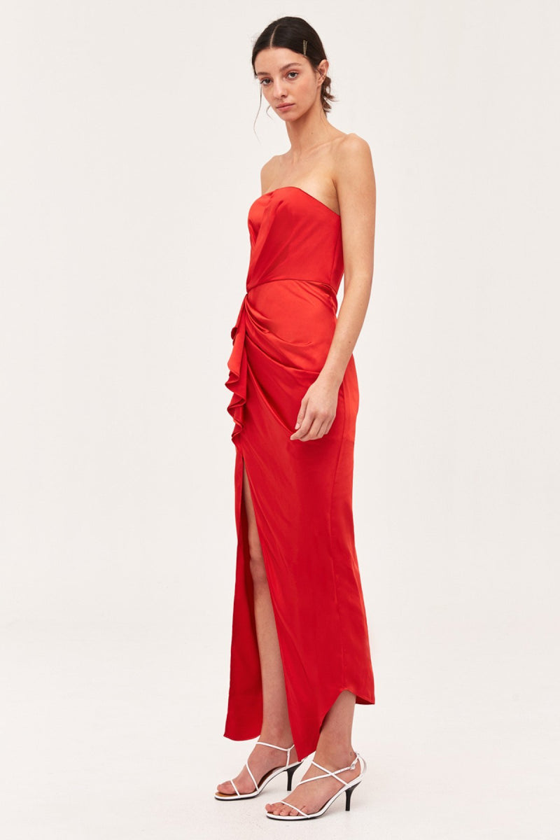 A real show-stopper in red! The My Way Gown designed by Cameo is a perfect dress for any holiday event or special occasion. This vibrant red silky fitted gown features a strapless boned bodice, draped detail and an elegant front high leg slit. Finished with a hidden back zipper closure.