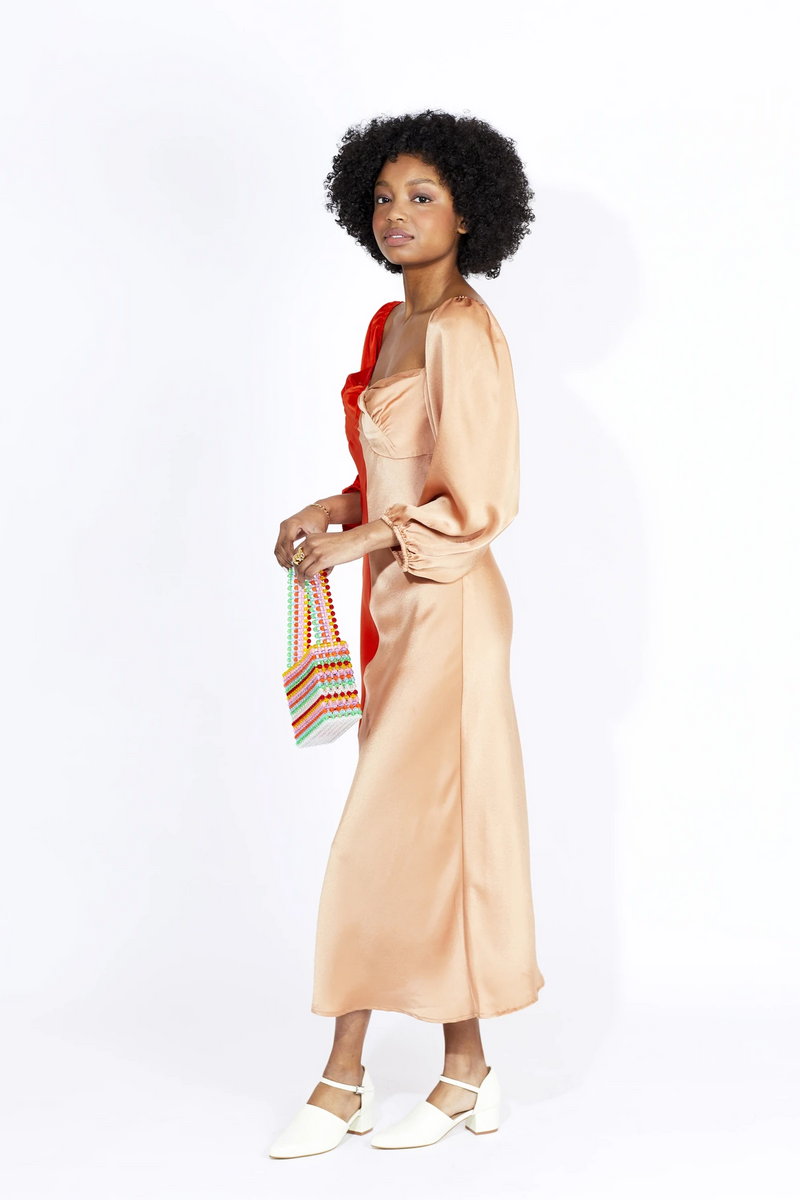 This vibrant vermilion and tan dress is made from a silky fabric with exaggerated balloon sleeves which add that beautiful vintage and romantic look. The Thoughtful Midi Dress Vermilion designed by Cameo is perfect for any date night or event.
