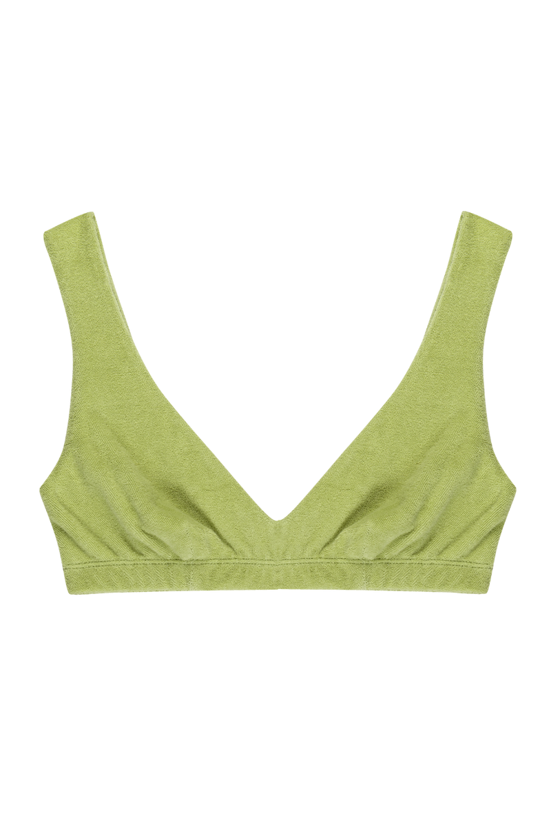 The Terry Bralette is the definition of lounge-lingerie. Layer underneath clothing or wear as is for a night out or your new WFH outfit. We promise this is the comfiest bra you will ever own, in a super soft terry made from a cotton blend. Pair with the matching shorts or sweatpants, designed by Donni.