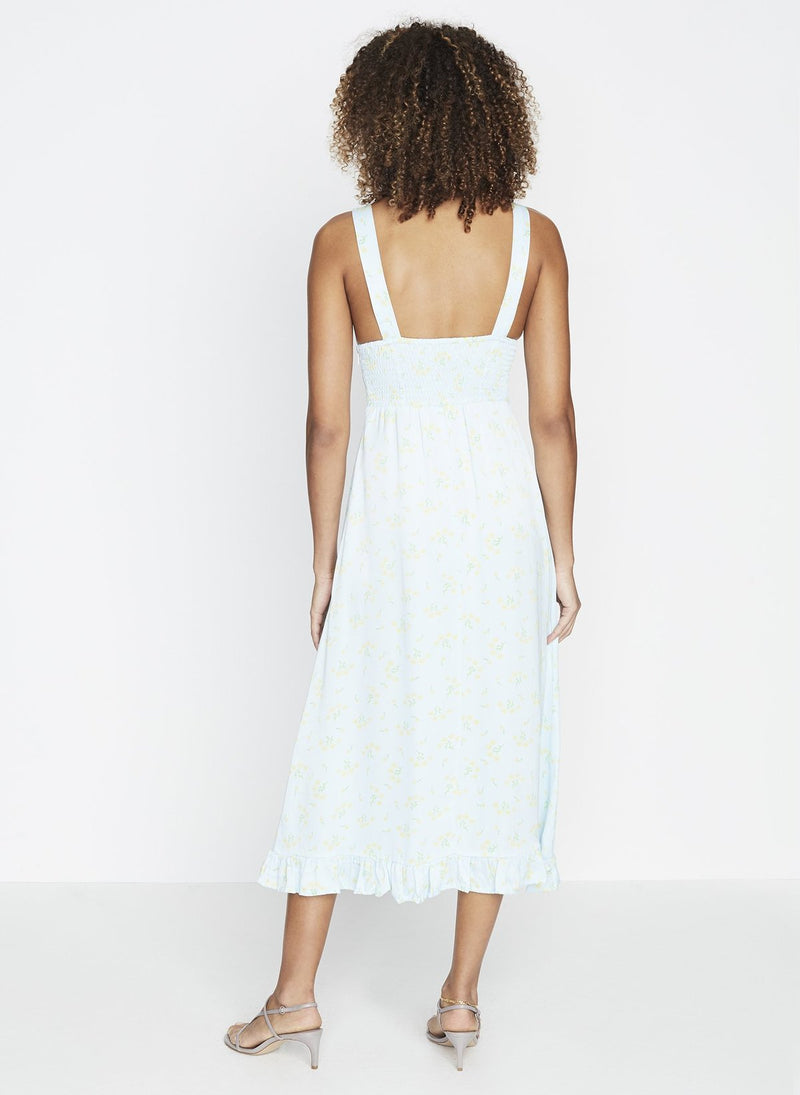 The 'Emili' sundress designed by Faithful is a retro midi dress featuring v neckline with self-fabric covered buttons and ruffled detailing along the skirt hemline. Add it to your vacation suitcase for your next PTO.
