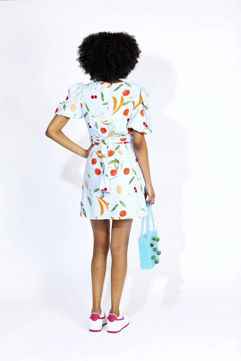 Effortless and fun, The Calypso SS Mini Dress designed by Finders Keepers is a fresh take on your classic summer mini dress. Featuring a stunning V-neck, fitted waist tie and stylish puffy sleeves! Do we even need to mention this fruit print is fabulous for your next brunch outing?