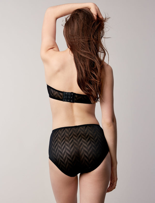 The strapless Vega Wire bra is made from a semi-sheer chevron jacquard lace, the vega wire is seamlessly held up through floating underwires, which adds structure to the piece. Made in Toronto, Canada.