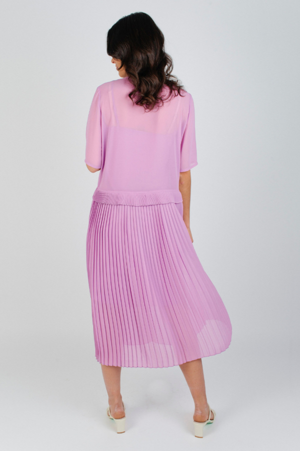 A sweet and flowy design, the Jose Dress is a piece worthy of a garden party. The orchid hue reminisces of the flower by its name, while the pleated skirt opens up softly, making it a perfectly blooming piece for Springtime activities. Spring wedding, anyone?