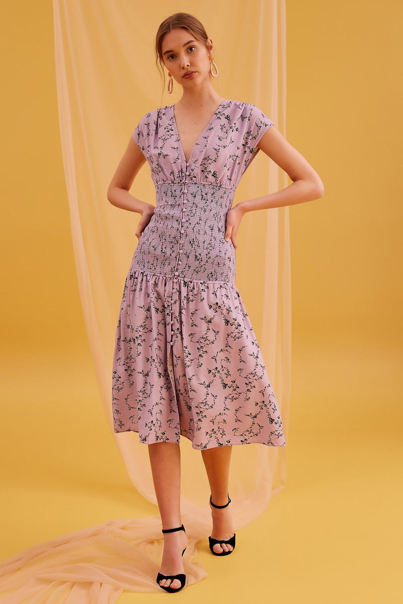 When in doubt, wear a damn floral dress to the wedding. This floral lilac Secure Midi Dress designed by Keepsake features a v neckline, elastic waistband, and short sleeves - it's the perfect plus one to your next guesting commitment.