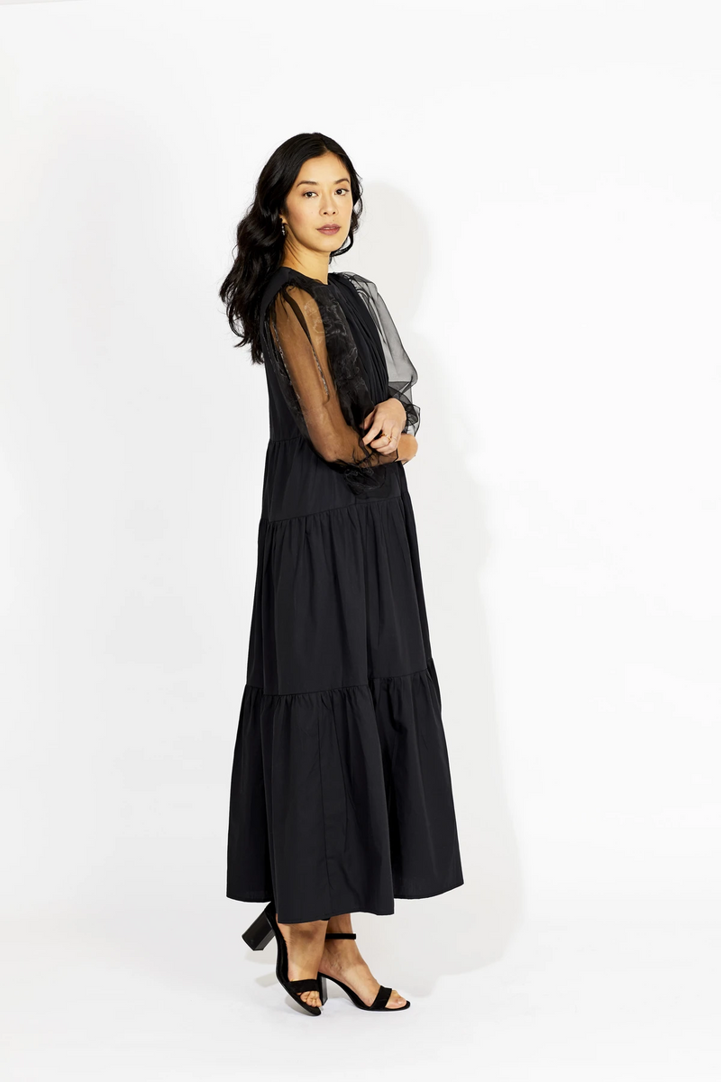 The Feline Dress designed by Le Petit Trou is a black dress made from 100% organic cotton with delicate puffy sleeves which add that beautiful vintage and romantic look. Made in Poland.