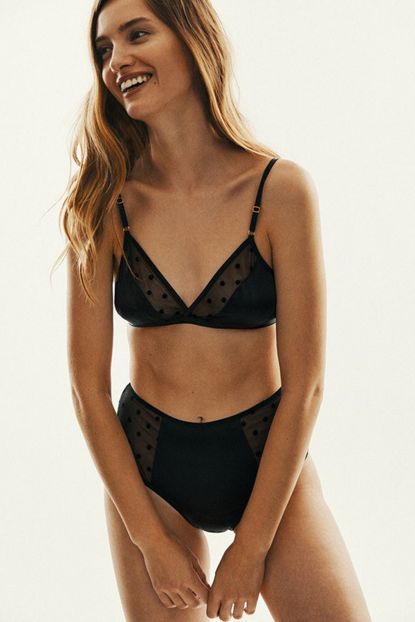 The Jade Bra features a wide triangle bra made of material in black, glitter dots and the filling of 100% silk, making it a perfect base for every season underwear set. Fastened with hooks at the back and the straps are easily adjustable. Designed by Le Petit Trou.