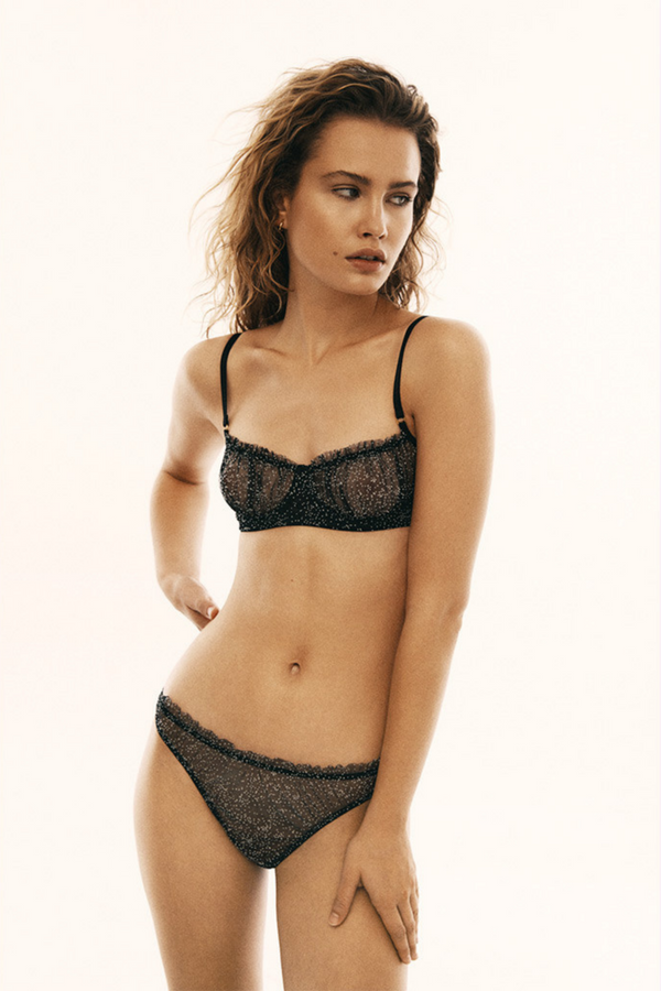 Designed by Le Petit Trou, the Mara low rise briefs are made of elastic and smooth black material in small white dots. Embellished with delicate ruffling around the waistband and small teardrop shaped opening at the back, closed with a gold buckle.
