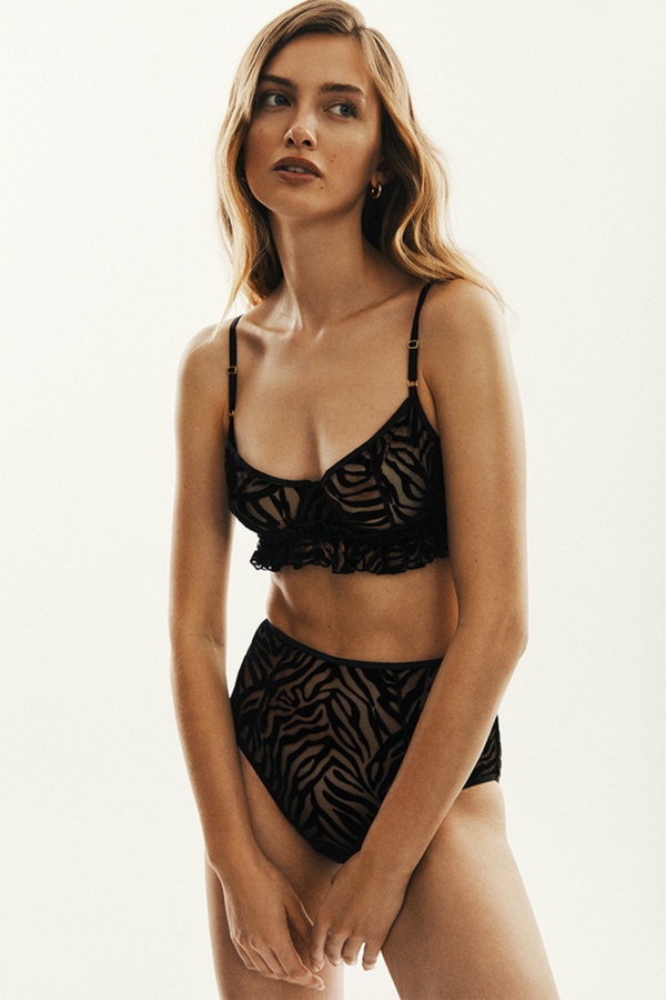 The Thea high waist brief is made of black material in flocked, zebra pattern, with high and tight fit that hold the silhouettes really nicely. The back embellished with a delicate, teardrop opening. Designed by Le Petit Trou.