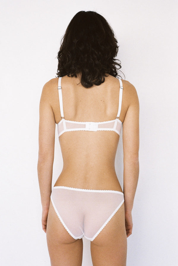 The Etta features velvet floral applique detail, sourced especially from our European mills. A teardrop shape cup with higher apex gives good coverage, and a full underwire provides good support. Cups feature subtle gather detail, shoulder straps are made in a comfortable stretch velvet. Designed by Lonely Hearts Lingerie.