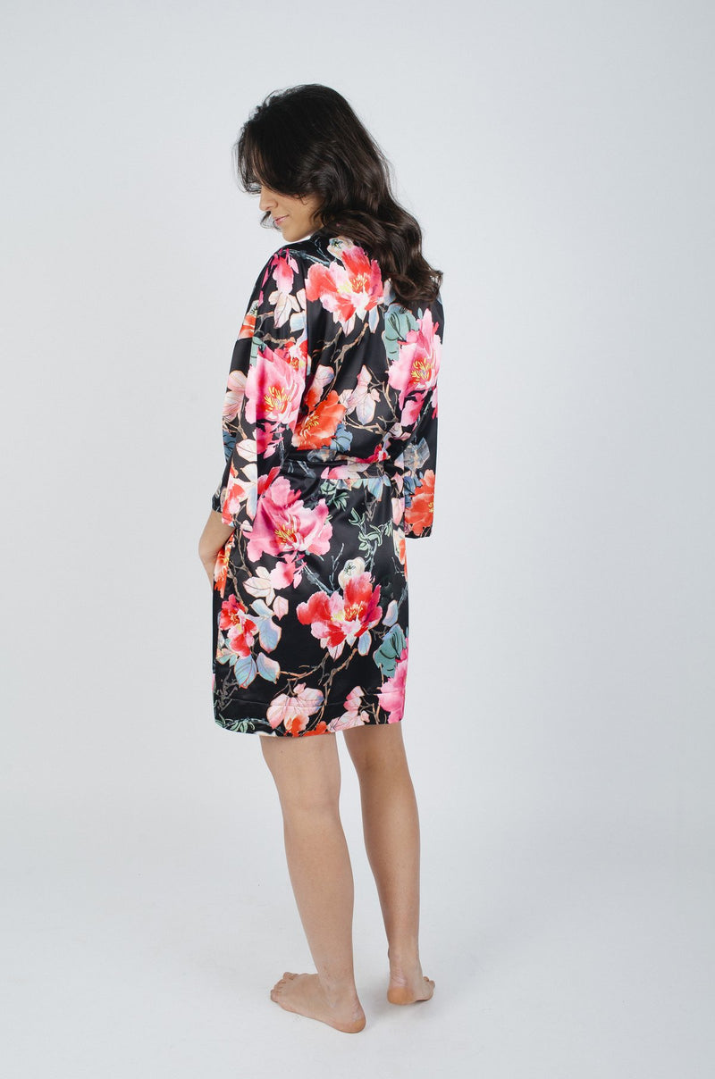 Whether you're getting ready for the big day or settling into your honeymoon, the Black Garden Floral Robe is perfect for all your love moments. This robe was designed by Loversland on a luxurious silk fabrication that features lace detailing along the edges of the sleeves. Giving your figure a feminine touch with the swingy fit and soft-waist tie, this romantic robe will set the mood wear after wear.