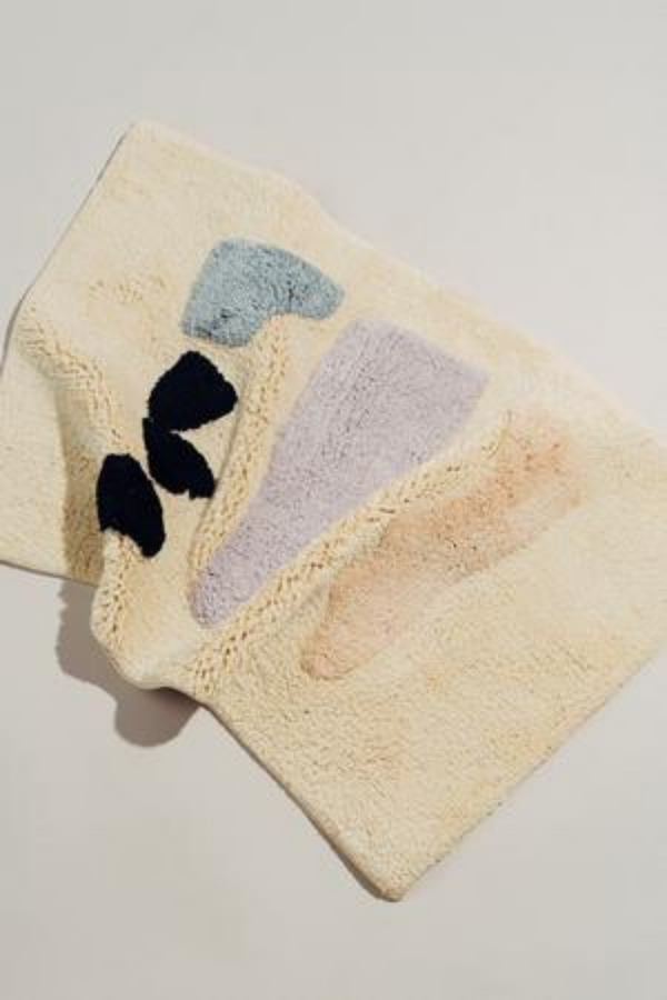 Make your bathroom experience all the more pleasant with the eye-catching & abstract Talking Rock bathmat.